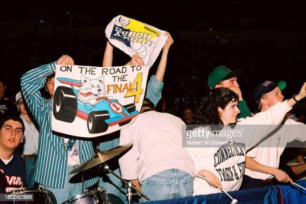 University of Connecticut's basketball fans hold up signs and cheer for the Huskies, New York, 1994.
