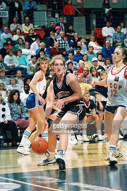 University of Connecticut's Meghan Pattyson drives the lane against the Russian National Team, Storrs, CT, 1990.