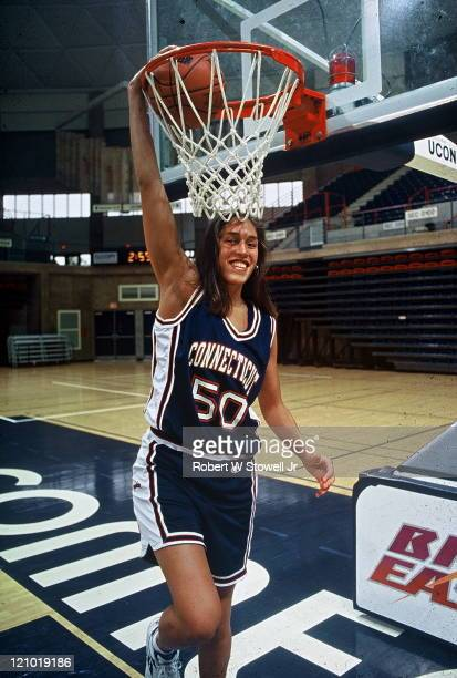 University of Connecticut's Rebecca Lobo starting center for the UConn Huskies basketball team brings the hoop down to her size while posing in...