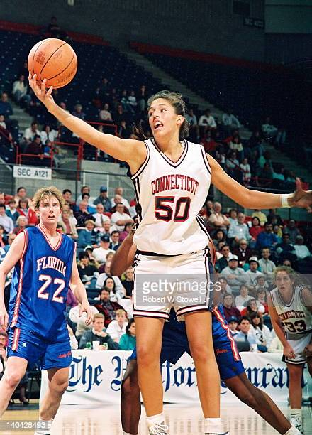 University of Connecticut's star player Rebecca Lobo rebounds the ball against the University of Florida Gampel Pavilion Storrs CT 1995