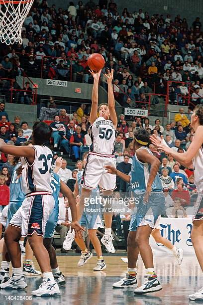 University of Connecticut's star player Rebecca Lobo shoots a jumpshot in the paint against the University of Rhode Island Gampel Pavilion Storrs CT...