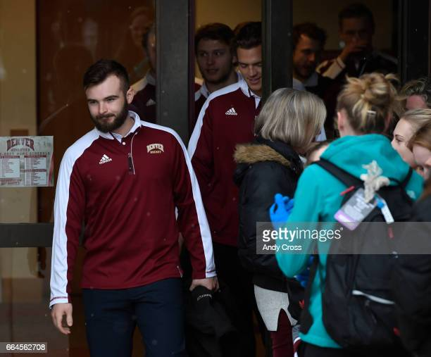 University of Denver Pioneers defenseman Will Butcher leads the hockey team out of the Ritchie Center to the bus during an official Frozen Four...