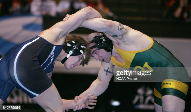 University of Dubuque's Evan Brown wrestles with Delaware Valley's Rocky Mantella during the Division III Men's Wrestling Championship held at the US...