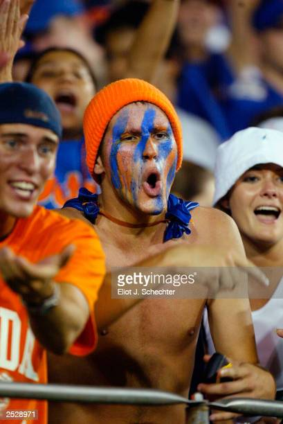 University of Florida Gator fans cheer their team on against the University of Miami Hurricanes on September 6, 2003 at The Orange Bowl in Miami...