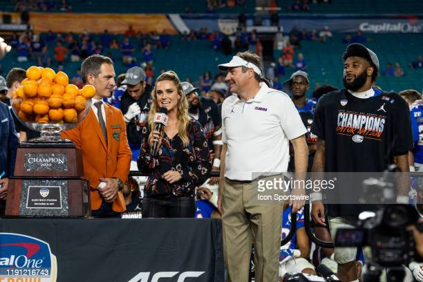 University of Florida Gators Coach Dan Mullen and MVP running back Lamical Perine with ESPN College Sports Reporter Molly McGrath during the Trophy...
