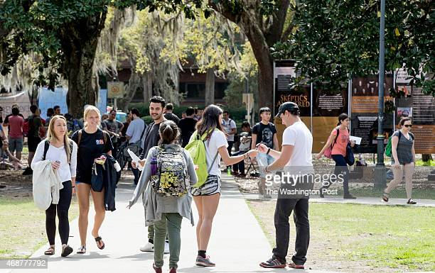 University of Florida students walk the campus on a sunny spring afternoon. The affirmative action numbers at Florida state universities have...