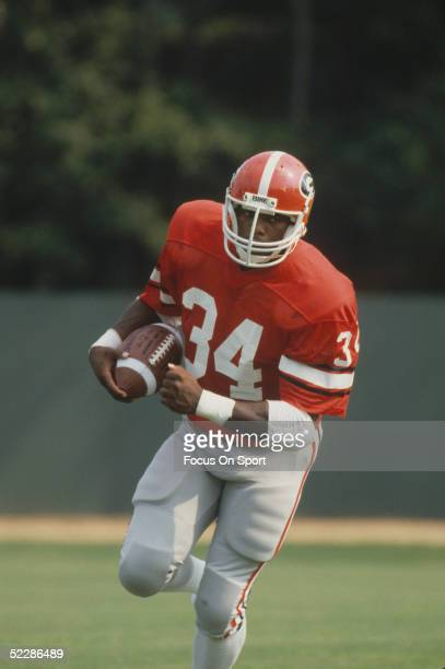 University of Georgia Bulldogs' running back Herschel Walker runs with the ball during a 1981 practice session Herschel Walker was elected to the...
