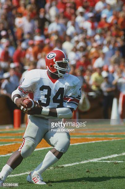 University of Georgia Bulldogs' running back Herschel Walker runs with the ball during a game in 1981. Herschel Walker was elected to the College...