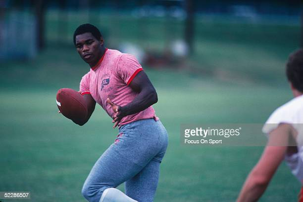 University of Georgia Bulldogs' running back Herschel Walker runs with the ball during a 1981 practice session. Herschel Walker was elected to the...