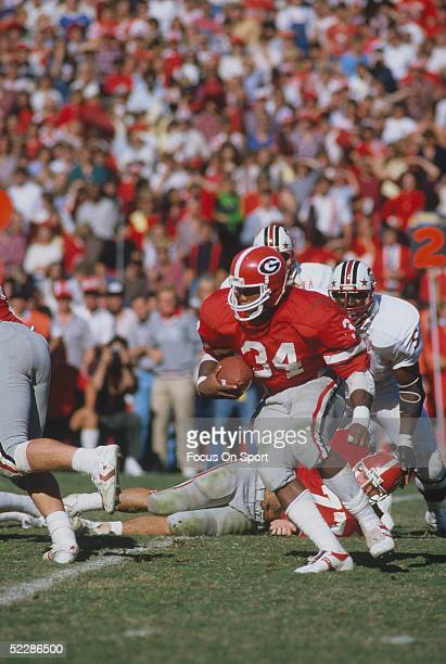 University of Georgia's running back Herschel Walker runs with the ball during a game circa 19801982 Herschel Walker was elected to the College...