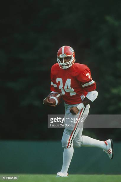 University of Georgia's running back Herschel Walker runs with the ball during practice circa 19801982 Herschel Walker was elected to the College...