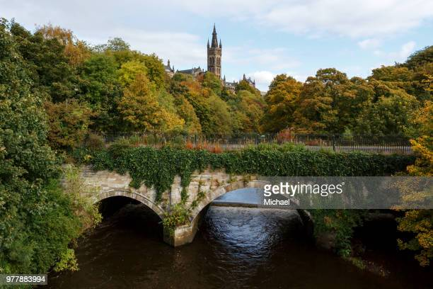 University of Glasgow behind lush trees, Glasgow, Scotland, UK