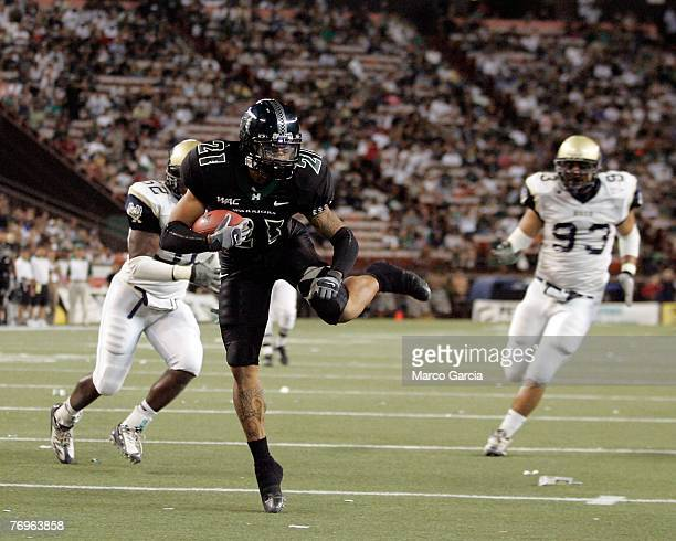 University of Hawaii Warriors DB Jakeem Hawkins runs in a touchdown against the Charleston Southern Buccaneers at Aloha Stadium September 22 2007 in...