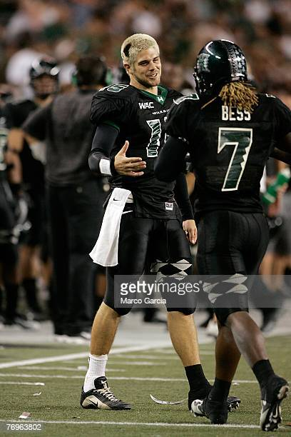 University of Hawaii Warriors QB Colt Brennan left congratulates WR Davone Bess after Bess ran in a touchdown during the fourth quarter against the...