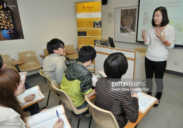 University of Hong Kong Korean Programme Director and Korean Language Instructor Kangsoon Lee teaching in the General Office of the School of Modern...