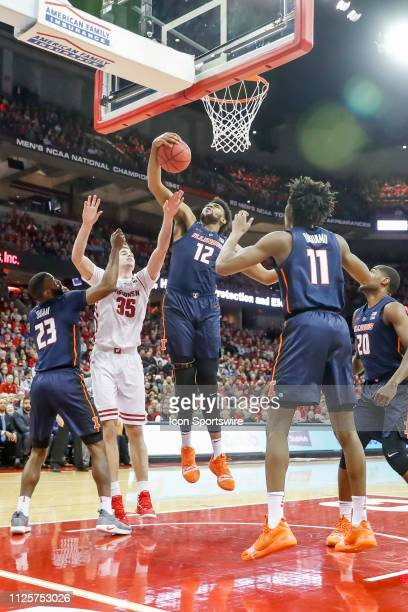 University of Illinois center Adonis De La Rosa comes down with the rebound in front of Wisconsin forward Nate Reuvers during a college basketball...