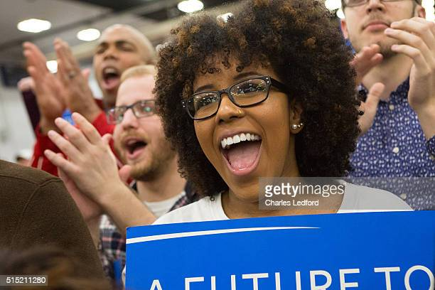 University of Illinois psychology student Amber Parker reacts as Democratic presidential candidate US Sen Bernie Sanders speaks in the Activities and...