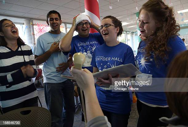 University of Illinois students Katy Pippins from left Warren D'Souza Jose Cuevas Clare Curtin and Kasia Stelmach sing Feliz Navidad for a caller...
