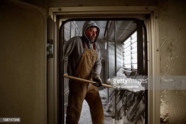 University of Iowa pipefitter Jeff Harland uses a shovel to dig out hundreds of pounds of snow that had blown into the Carver Biomedical Reseach...