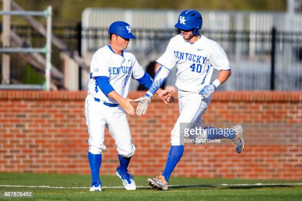 University of Kentucky assistant coach Roland Fanning celebrates outfielder Zach Reks home run during a regular season college baseball game between...
