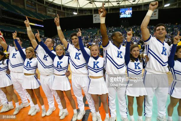 University of Kentucky Wildcats cheerleaders perform during the SEC Men's Basketball Tournament Championship game against the University of Florida...