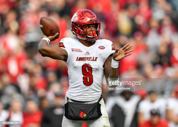 University of Louisville Cardinals quarterback Lamar Jackson throws a pass from the pocket during the second half of the TaxSlayer Bowl game between...
