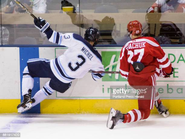 University of Maine defenseman Rob Michel is tripped up by Boston Universitys Brady Tkachuk during Hockey East action at the Cross Insurance Arena on...