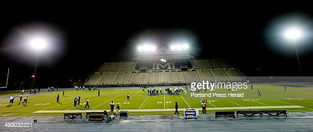 University of Maine football team practices under the lights at Harold Alfond Sports Stadium in Orono Wednesday, November 20, 2013.
