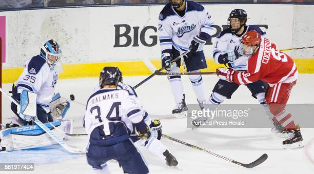 University of Maine goalie Rob McGoverngets in front of the puck shot by Boston Universitys Logan Cockerill during Hockey East action at the Cross...