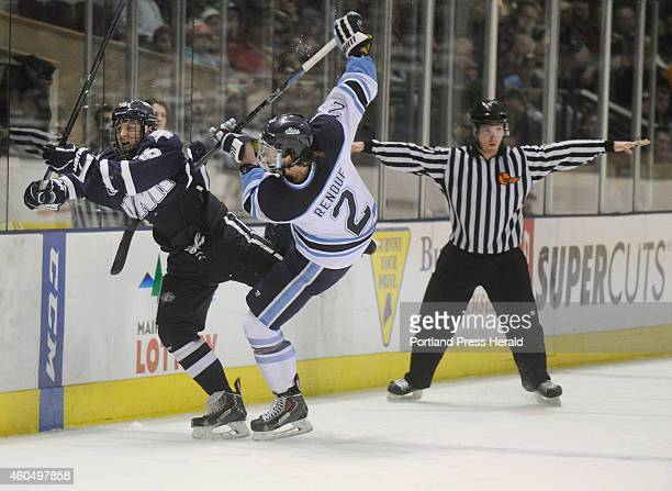 University of Maine mens hockey game against the University of New Hampshire at the Cross Insurance Arena in Portland UNH's Matt Willows takes a hard...