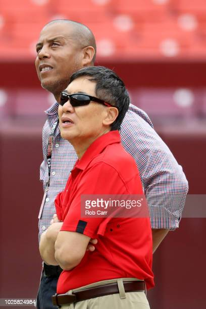 University of Maryland athletic director Damon Evans and university president Wallace Loh watch pregame before the start of the Maryland Terrapins...