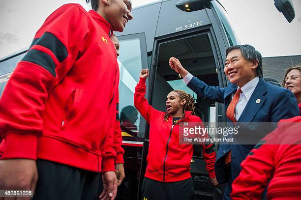 University of Maryland President Wallace Loh right leads a cheer of kick some butt as the women's basketball players including Maryland Terrapins...