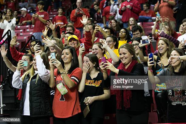 University of Maryland students react as first lady Michelle Obama acknowledges them during men's NCCA basketball game between University of Maryland...