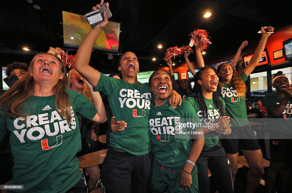 University of Miami basketball players Adrienne Motley and Jessica Thomas, center, celebrate with their teamamtes on Monday, March 13, 2017 as they realize they will be playing at home in the NCAA women's basketball tournament.