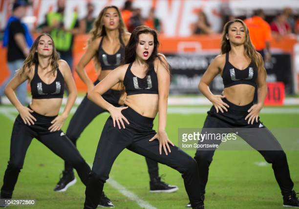 University of Miami dancers perform on the field during the college football game between the North Carolina Tar Heels and the University of Miami...