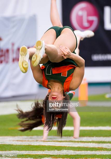 University of Miami Hurricanes cheerleader flips upside down as she performs during the NCAA college football game between the Duke Blue Devils and...