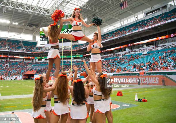 University of Miami Hurricanes cheerleaders perform during the college football game between the BethuneCookman Wildcats and the University of Miami...