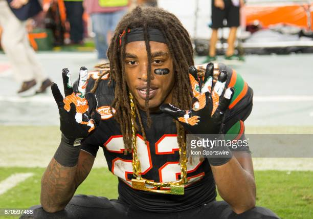 University of Miami Hurricanes Defensive Back Sheldrick Redwine celebrates with the UM Turnover Chain after intercepting a pass from Virginia Tech...