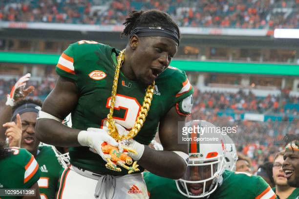 University of Miami Hurricanes Defensive Back Trajan Bandy wears the Turnover Chain as he celebrates recovering a fumble from Savannah State Tigers...