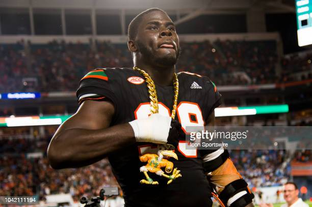 University of Miami Hurricanes Defensive Lineman Joe Jackson celebrates with the UM Turnover Chain after intercepting the ball and running it back...