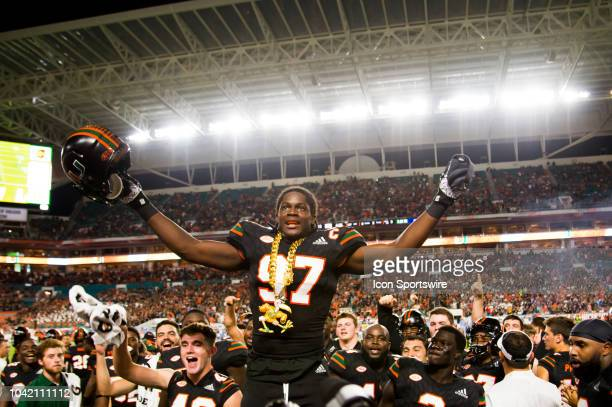 University of Miami Hurricanes Defensive Lineman Jonathan Garvin celebrates with the UM Turnover Chain after recovering a fumble and running it back...