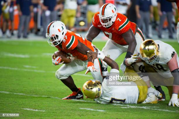 University of Miami Hurricanes Defensive Lineman Jonathan Garvin recovers the fumble after sacking Notre Dame Quarterback Brandon Wimbush during the...