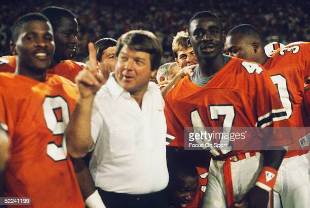 University of Miami Hurricanes head coach Jimmy Johnson celebrates with Michael Irvin following the game against the Notre Dame Fighting Irish at the...