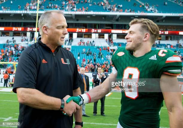 University of Miami Hurricanes Head Coach Mark Richt and University of Miami Hurricanes Wide Receiver Braxton Berrios shake hands on the field after...