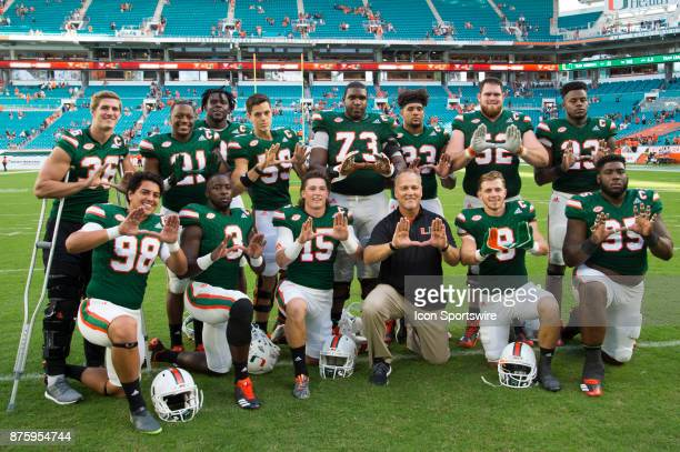 University of Miami Hurricanes Head Coach Mark Richt poses with seniors University of Miami Hurricanes Kicker Diego Marquez University of Miami...