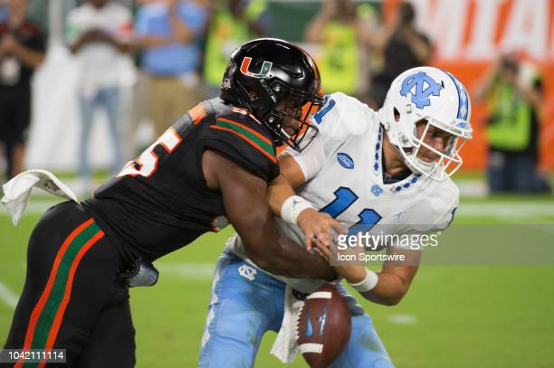 University of Miami Hurricanes Linebacker Shaquille Quarterman hits North Carolina Tar Heels Quarterback Nathan Elliott causing a fumble which was...