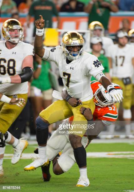 University of Miami Hurricanes Linebacker Zach McCloud tackles Notre Dame Quarterback Brandon Wimbush during the college football game between the...