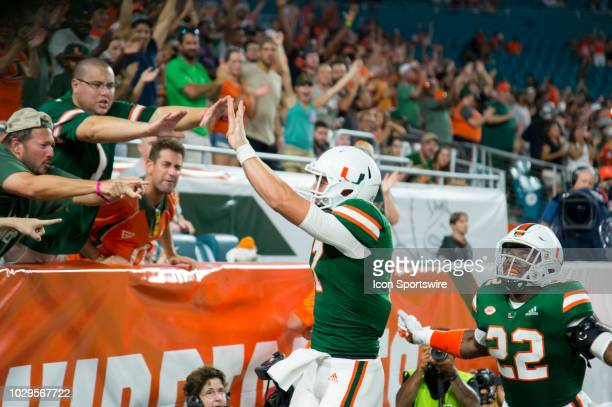 University of Miami Hurricanes Quarterback Cade Weldon gives the U sign and celebrates scoring a touchdown with fans and University of Miami...
