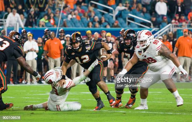 University of Miami Hurricanes quarterback Malik Rosier scrambles for yards as Miami Hurricanes compete against the University of Wisconsin Badgers...