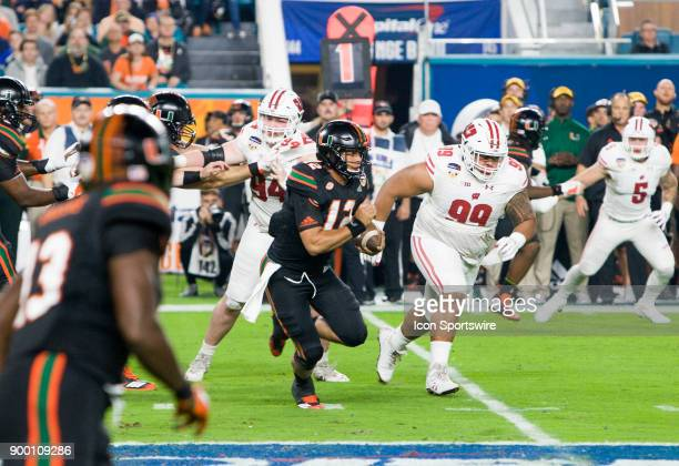 University of Miami Hurricanes quarterback Malik Rosier scrambles during the first half as Miami Hurricanes compete against the University of...
